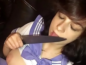 Cute young legal age teenager fucks herself with a knife