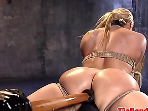 Tied sub gets anally dildoed by maledom