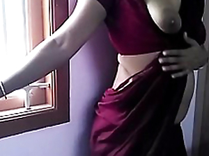 HOT INDIAN Filly Regarding SAREE STRIP TEASE AND Be captivated by