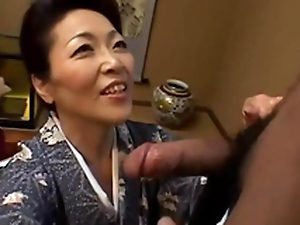 Japanese granny takes a blowjob