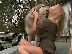 Sultry plus sweltering bit of skirt kisses a dog on an obstacle porch of an obstacle house
