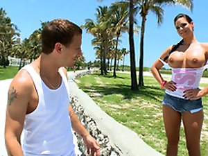 Temerarious brunette Phoenix Marie flashes XXX coconuts in the street