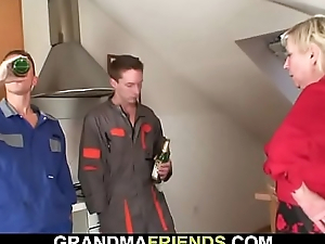 Nasty old granny spreads trotters for two dicks